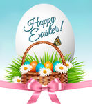 Happy Easter background. Colorful eggs and basket Stock Images