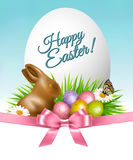 Happy Easter background. Colorful eggs and chocolate bunny Royalty Free Stock Images