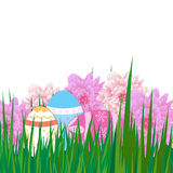 Happy Easter background with colorful eggs, grass and pink flowe Stock Images