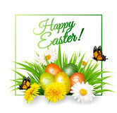 Happy Easter background. Colorful eggs on green grass Royalty Free Stock Photo