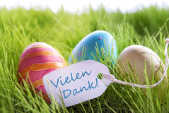 Happy Easter Background With Colorful Eggs And Label With German Text Vilene Dank. Colorful Easter Background With Three Easter Eggs And Label With German Text stock photo