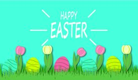 Happy Easter background with colorful eggs and tulips in bright green grass royalty free stock images