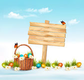 Happy Easter background. Easter eggs and wooden sign Royalty Free Stock Photography