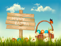 Happy Easter background. Easter eggs and wooden sign Stock Photo