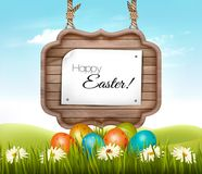 Happy Easter background. Eggs in a green grass Royalty Free Stock Photo
