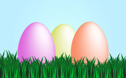Happy easter. Background of green grass and blue sky with three colorful eggs Royalty Free Stock Photos