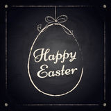Happy easter background with hanging egg on chalkboard Royalty Free Stock Images
