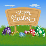 Happy Easter Background. Painting Eggs Hidden on Grass and Happy Easter Typographic on Wooden Sign Board. Vector illustration Royalty Free Stock Image