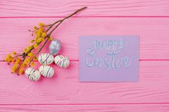 Happy Easter background with pussy willow. Easter styrofoam eggs, yellow pussy willow twig and greeting card. Spring and Easter holidays Royalty Free Stock Photos