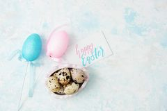 Happy easter background with quail eggs, decor and greeting card. Holiday concept. Text space Stock Images
