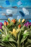 Happy easter background with yellow tulips stock image