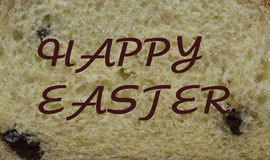 HAPPY EASTER. Baking texture. cut slice of pie with raisins. HAPPY EASTER written on the bakery product Stock Photo