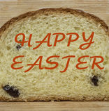 HAPPY EASTER. Baking texture. cut slice of pie with raisins. HAPPY EASTER written on the bakery product Royalty Free Stock Photography