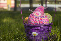 Happy Easter. A Basket of Easter eggs on a sunny day in the park Stock Images