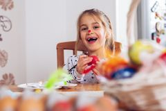 Happy easter. A beautiful child girl painting Easter eggs stock image