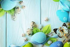 Happy easter. blue colored easter on the blue wooden background. free space for text royalty free stock images