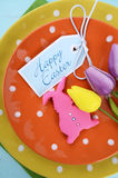 Happy Easter bright color orange, yellow and green polka dot theme table place setting Stock Images