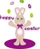 Happy Easter Bunny. Easter Bunny juggling eggs with happy easter text Royalty Free Stock Photography