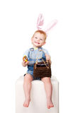 Happy Easter Bunny baby laughing. Stock Photo