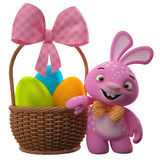 Happy Easter bunny with eggs in basket Royalty Free Stock Photo