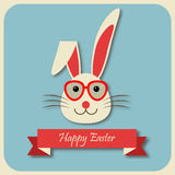 Happy Easter bunny with glasses. On blue background. Vector illustration Royalty Free Stock Photo