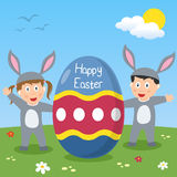Happy Easter Bunny Kids. Two happy kids dressed as bunnies with a big Easter egg in a park with flowers. Useful also as Easter greeting card. Eps file available stock illustration