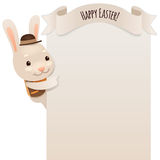 Happy Easter Bunny Looking at Blank Poster Royalty Free Stock Photography