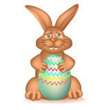Happy Easter Bunny. Pleased chocolate bunny with Easter egg Stock Images