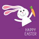 Happy Easter. Bunny rabbit hare with carrot in the pocket. Baby greeting card. Violet background. Flat design. Royalty Free Stock Images