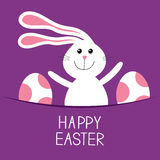 Happy Easter. Bunny rabbit hareand pained egg in the pocket. Baby greeting card. Violet background. Flat design. Stock Photos