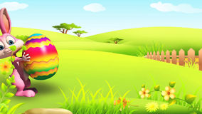 Happy Easter bunny walking with colorful big egg