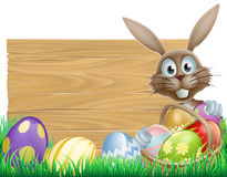 Happy Easter bunny and wooden sign Stock Photo