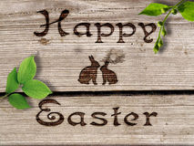 Happy Easter - burned an inscription on a wood. Stock Photos