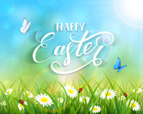 Happy Easter and butterflies flying over flowers. Nature Easter background with a butterfly flying above the grass and flowers, lettering Happy Easter and sun Royalty Free Stock Photography