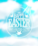 Happy Easter calligraphic design against blue sky. Royalty Free Stock Photos
