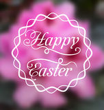 Happy Easter calligraphic headline, blurred background Stock Photography