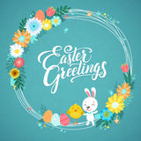 Happy Easter Calligraphy Greeting Card. Modern Brush Lettering and Floral Wreaths. Joyful wishes, holiday greetings. Pastel background Royalty Free Stock Photos