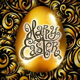 Happy Easter. Calligraphy lettering. Beautiful greeting card. golden egg with abstract gold ornament. Vector. black backround. Art Stock Photos