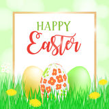 Happy Easter card, banner, flyer, invitation template. Painted eggs in fresh green grass, bright flowers and lettering Royalty Free Stock Photo