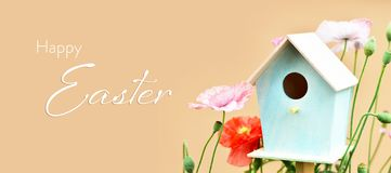 Happy Easter card with bird house and flowers. Happy Easter card with little bird house and flowers stock images