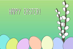 Happy Easter card. Easter card with catkins and colorful eggs on green background Stock Photo