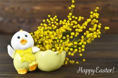 Happy Easter card with Easter chicken and spring flowers Royalty Free Stock Photos