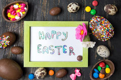 Happy Easter card and chocolate eggs Stock Image