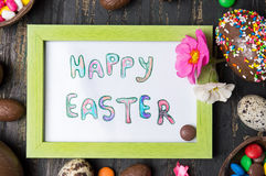 Happy Easter card and chocolate eggs Stock Photos
