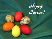 Happy Easter card with easter eggs. Happy Easter card and colorful Easter eggs on greem background royalty free stock photography