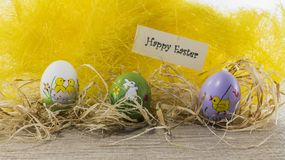 Happy easter card with copy space and yellow background stock photography