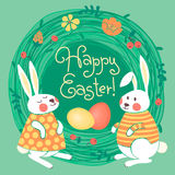 Happy Easter card with cute bunnies and colored Stock Photography