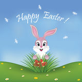 Happy Easter card with a cute pink bunny finding eggs Stock Image