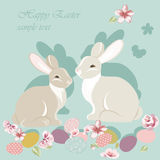 Happy Easter card with cute rabbits Stock Photos