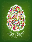 Happy Easter Card. Doodle ornate colorful floral egg and lettering on green background. Stock Image